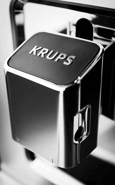 photographe nature morte post production krups machine cafe logo